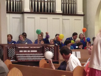 The Choir enthusiastically participating in the task of handing out %22Holy Spirit Balloons%22 following the Children's message, 5-19-2013